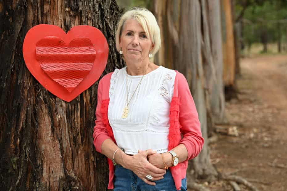 Jacinda's mother Deb Barclay standing next to the hearts which were originally placed on the trees as part of Jacinda's Memorial.