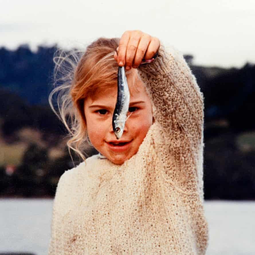 Jacinda Barclay holding up a fish