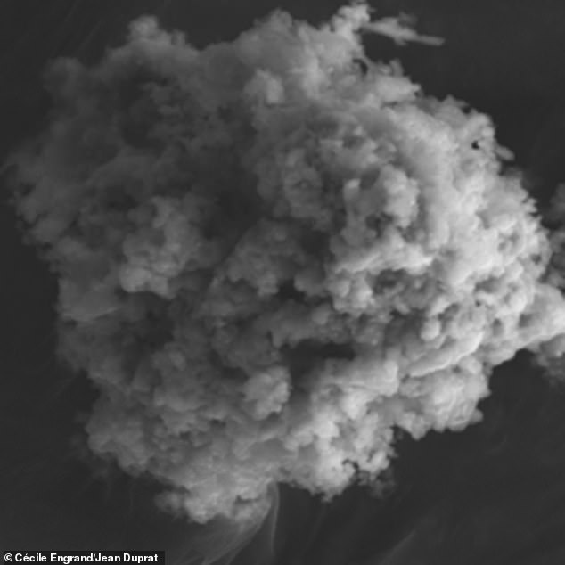 More than5,000 tons of microscopic particles from outer space, known as micrometeorites, lands on Earth every year, according to a new report fromthe French National Center for Scientific Research (CNRS). Pictured is an electron microphotograph of an unmelted micrometeorite found in Antarctica