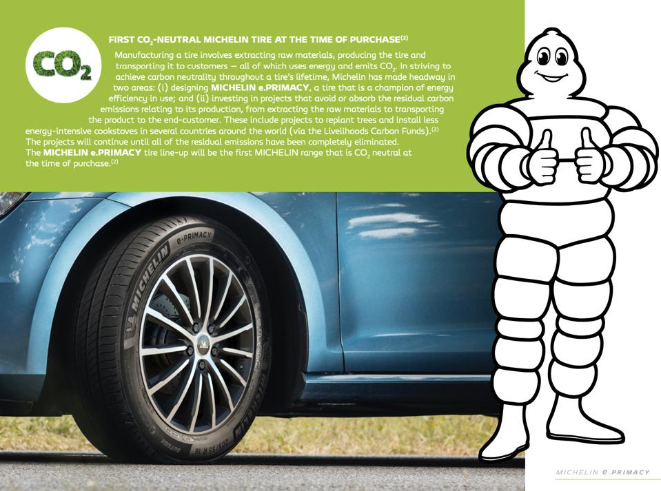 The Michelin Man mascot, with the company's latest tires for electric vehicles