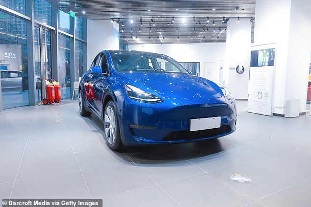 The company said its cars are currently at Level 2, which means they can control steering and accelerating/decelerating, but with a human in the driving seat. Pictured: A Tesla car in Shanghai