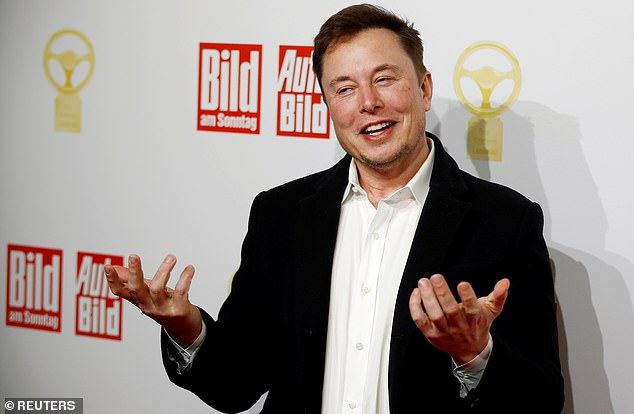 Musk has made lofty predictions that he company would be able to have auto pilot by the end of the year. Pictured: Musk arrives on the red carpet for automobile awards in Germany, 2019