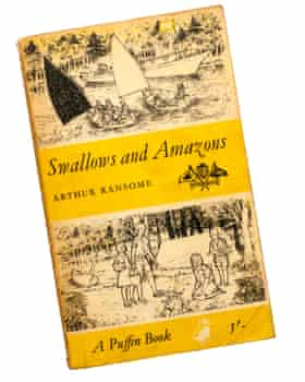 A paperback copy of Swallows and Amazons by Arthur Ransome