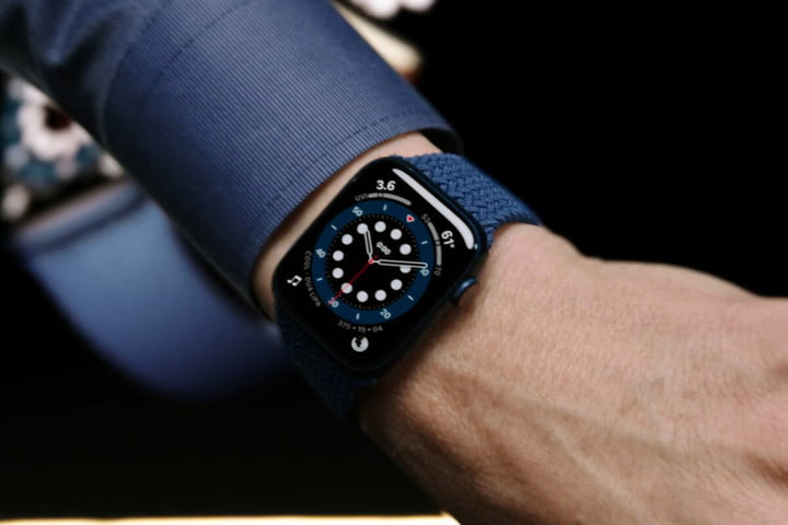 Close up of a man showing off the Apple Watch Series 6 on his wrist