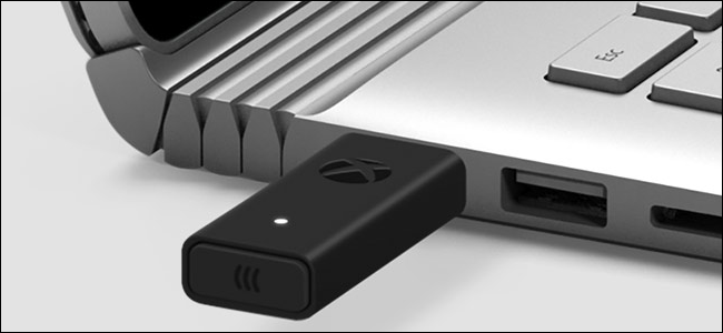 Xbox Wireless Adapter accessory connected to a Windows laptop