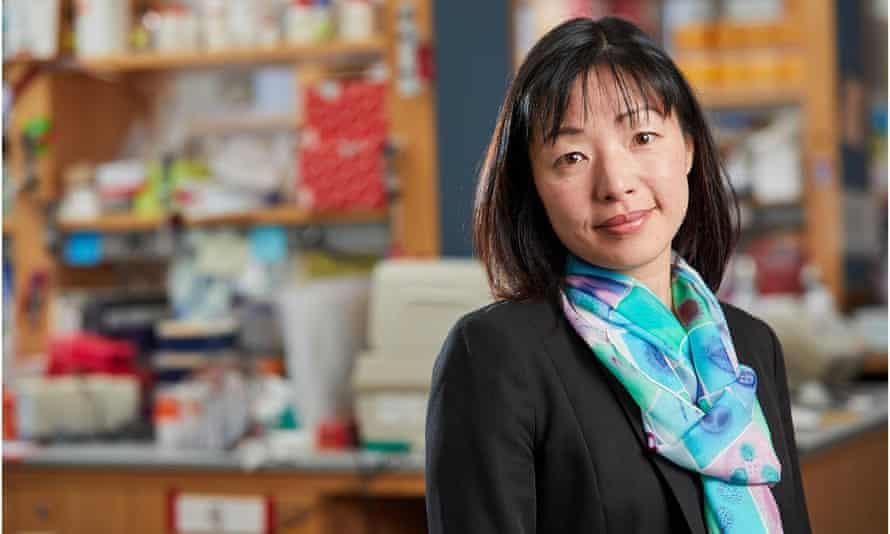 prof akiko iwasaki in a lab, smiling