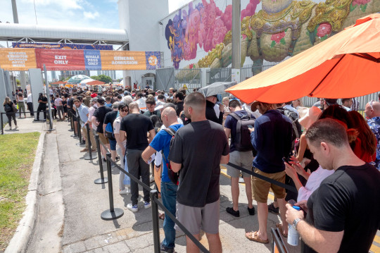 Hundreds of people are waiting on a line to attend the Bitcoin 2021 Convention