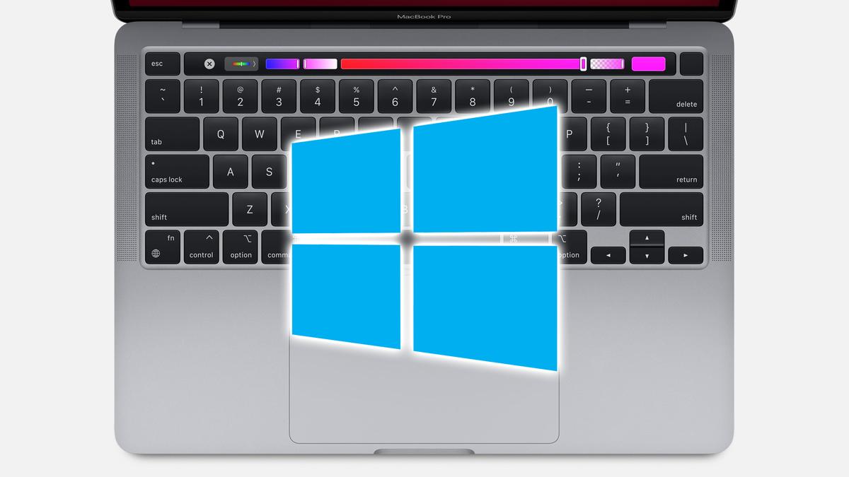 The Windows 10 logo over a MacBook Pro