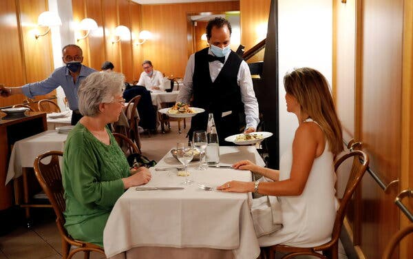 People dined at a restaurant in Rome on Thursday. The Italian government announced restrictions for people who have not been vaccinated, barring them from taking part in social activities like dining indoors.