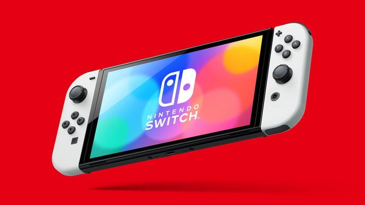 White Nintendo Switch OLED in handheld mode.