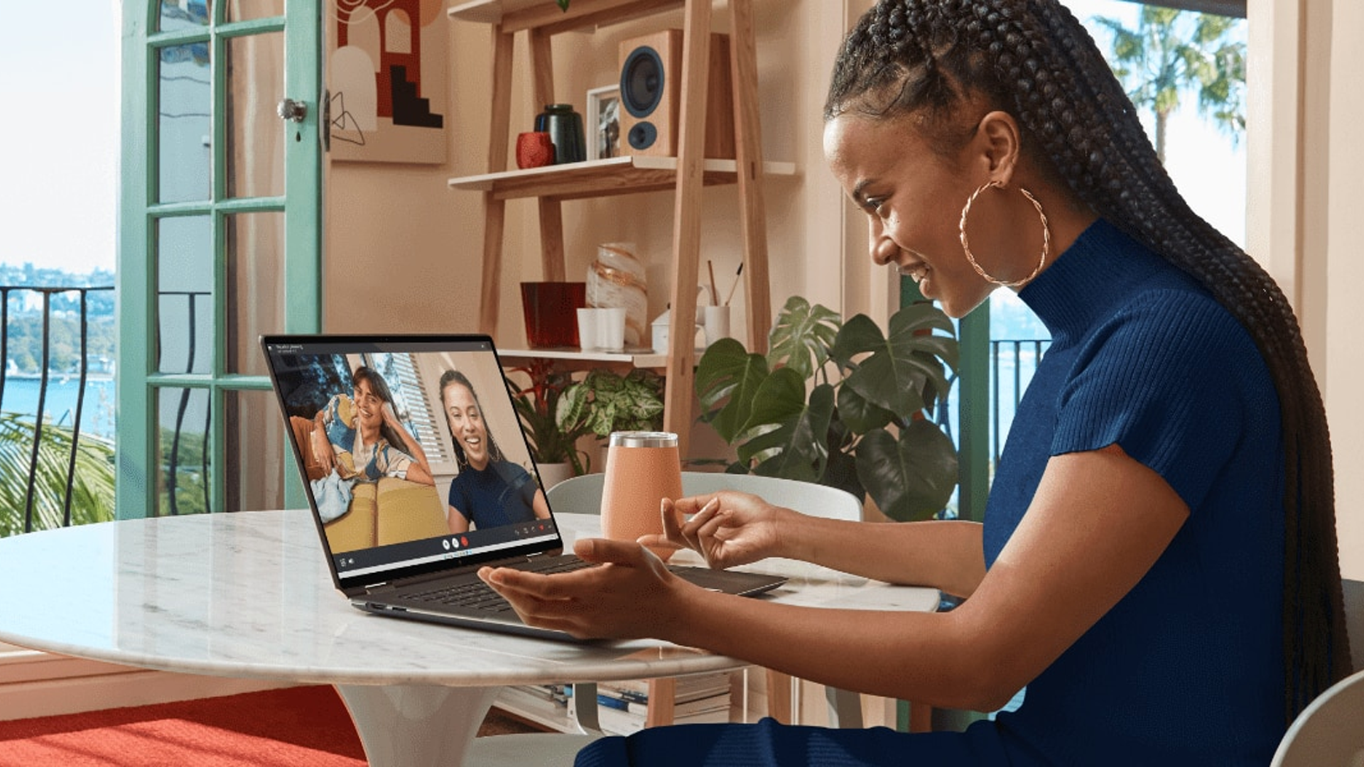 Someone taking a video call on the HP Spectre x360 16-inch laptop.