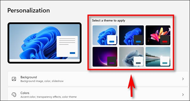 In Windows 11 Personalization settings, click a theme thumbnail at the top to change themes quickly.