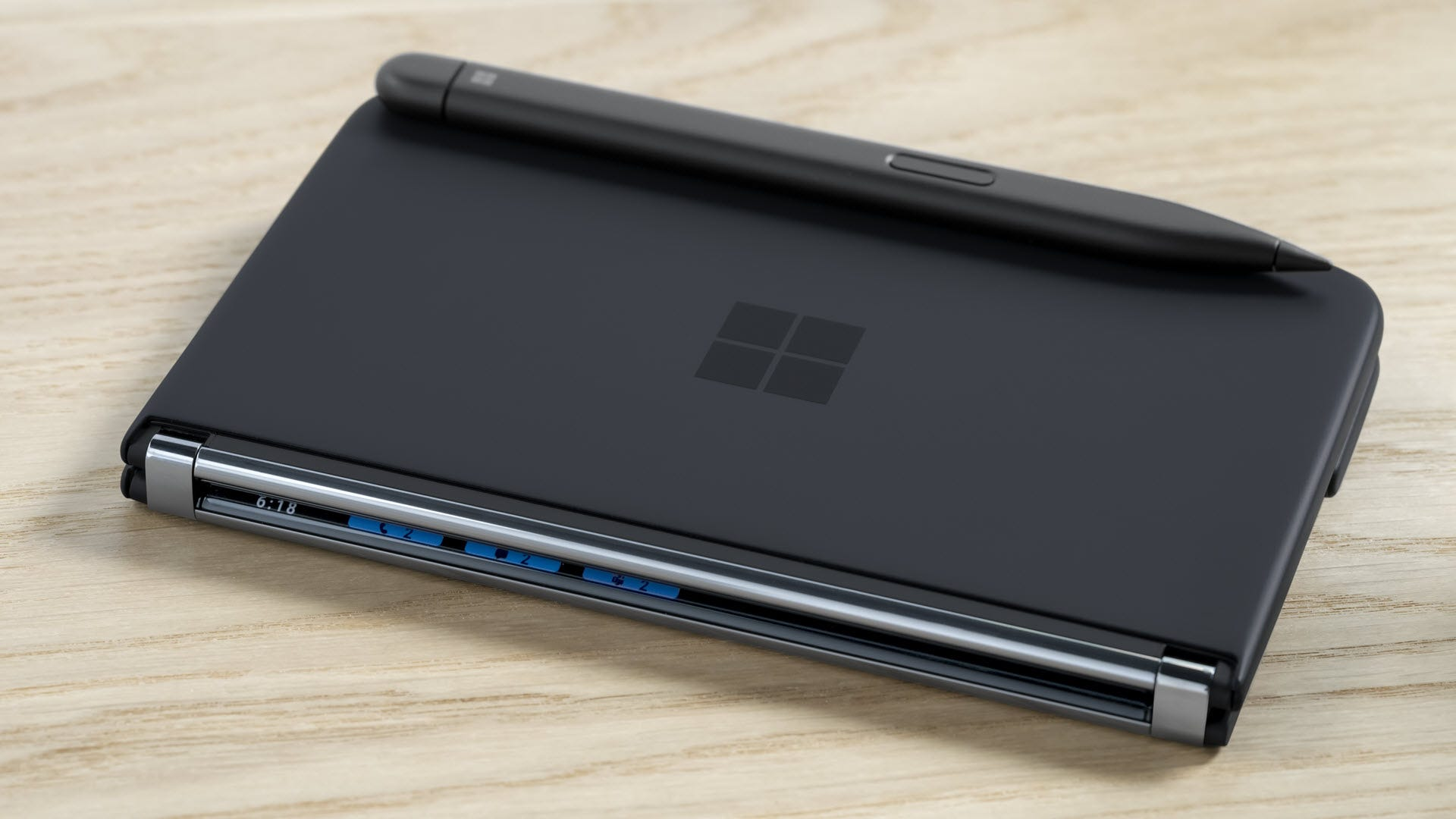 A Surface Duo 2 with a magnetically attached Pen.