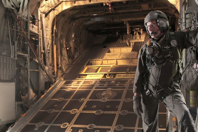 Air Force Command Sgt. Maj. Archie Branton waits to open the back ramp for soldiers to perform a static line parachute jump from a C-130 Hercules aircraft during the Wings Over Pittsburgh Open House, Pa., May 13, 2017. Branton is a loadmaster assigned to the 911th Air Wing and 758th Airlift Squadron. The soldiers are assigned to the West Virginia Army National Guard's 2nd Battalion, 19th Special Forces Group. Army photo by Staff Sgt. Shaiyla Hakeem