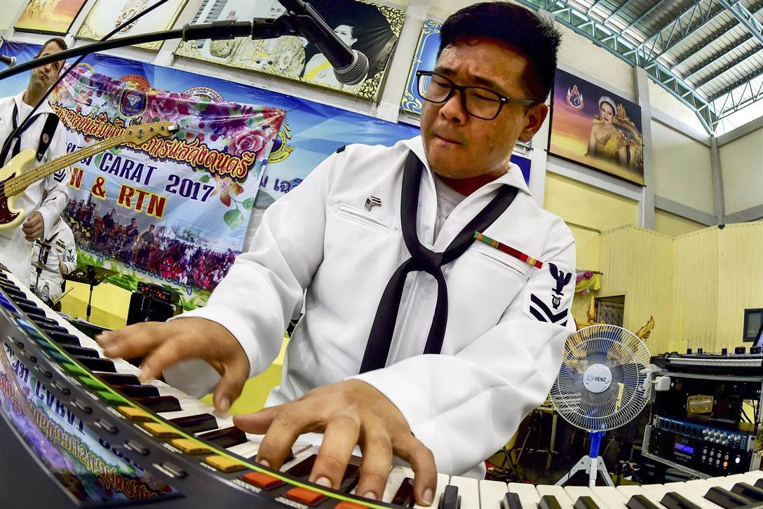 Navy Petty Officer 2nd Class Daniel Park jams at a band performance during Cooperation Afloat Readiness and Training Thailand 2017, an annual exercise, in Pattaya, Thailand, June 2, 2017. Navy photo by Petty Officer 1st Class Micah Blechner