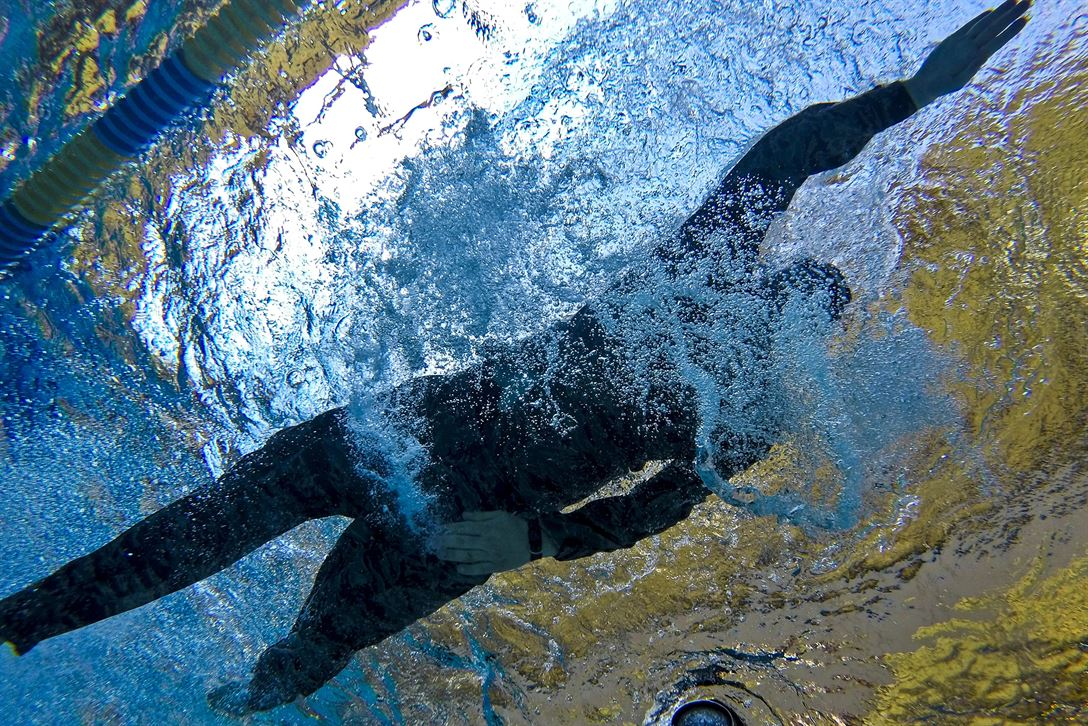 An airman swims a 100-meter challenge during a test for the German Armed Forces Badge for Military Proficiency at Joint Base McGuire-Dix-Lakehurst, N.J., June 13, 2017. The airman is assigned to the New Jersey Air National Guard's 108th Security Forces Squadron. Air National Guard photo by Master Sgt. Matt Hecht
