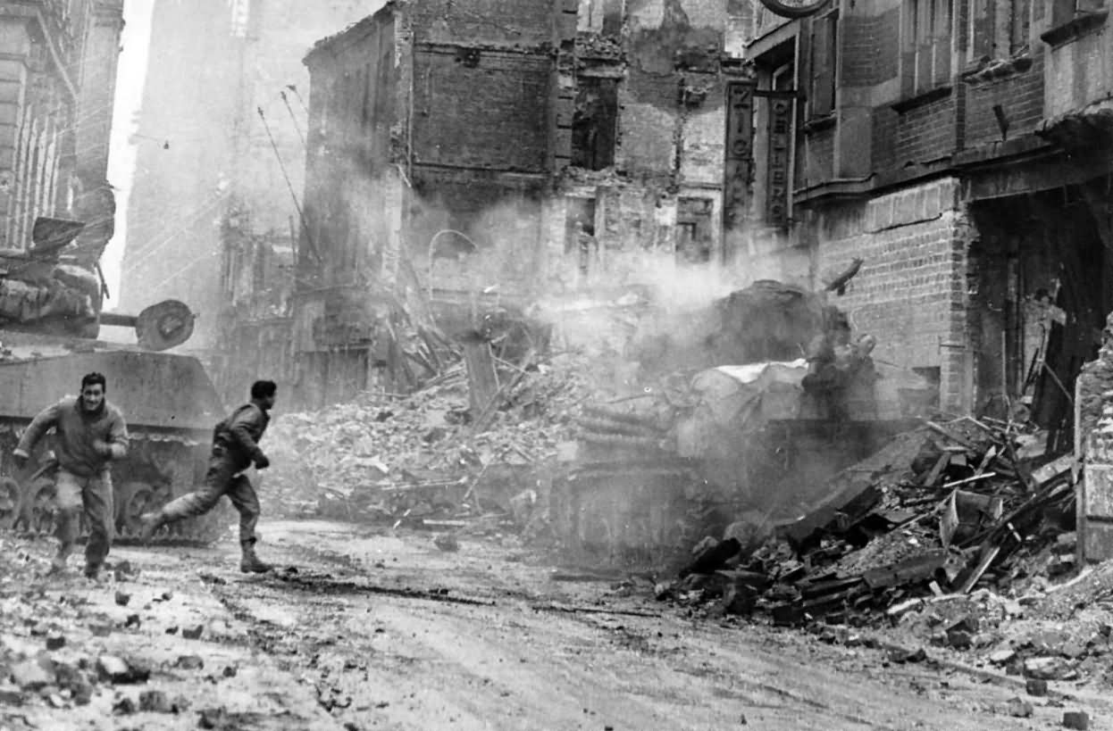 M4_Sherman_Tank_Hit_By_Shell_Near_Cologne_Cathedral_1945.jpg