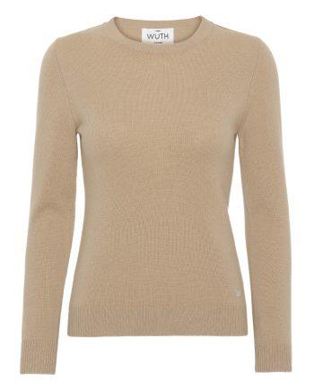 Vores klassiske cashmere bluse fra Wuth Cashmere er perfekt til et klassisk look. Find vores klassisk pullover i flere flotte farver. Vores yndlings er denne fine beige farve.