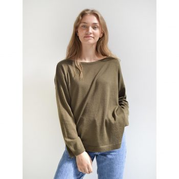 Our model in Julie Pullover in a beautiful olive green color. Oversize sweater with boat neckline.