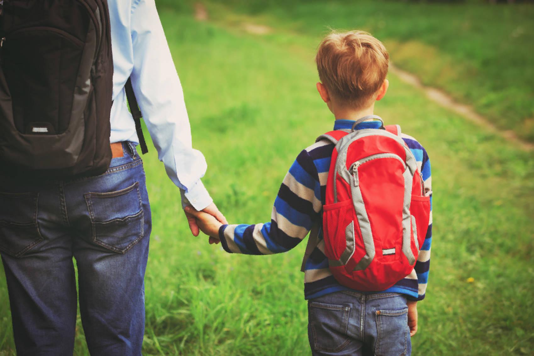 Father walking son to school or daycare. Copyright nadezhda1906 - fotolia